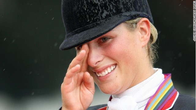 Aachen, GERMANY: British rider Zara Phillips gestures during the awarding ceremony of the Eventing competition of the World Equestrian Games in Aachen 27 August 2006. Phillips won the gold medal in the individual competition and the silver medal with her British team in the team competition. AFP PHOTO DDP/JOCHEN LUEBKE GERMANY OUT (Photo credit should read JOCHEN LUEBKE/AFP/Getty Images