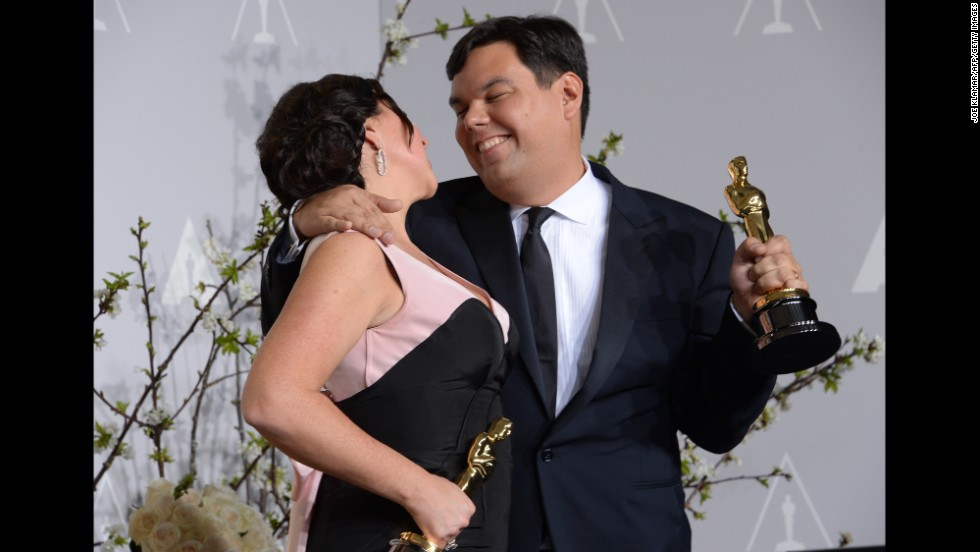 "Robert Lopez, right, became the youngest EGOT recipient -- the winner of an Emmy, Grammy, Oscar and Tony -- when he won the best original song Oscar for ""Let It Go."" He co-wrote the song with his wife, Kristen Anderson-Lopez."