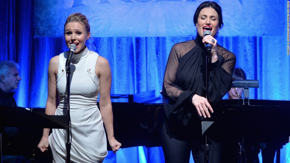 "The voices of Kristen Bell (Anna, left) and Idina Menzel (Elsa) are all over the ""Frozen"" soundtrack, which spent 13 weeks at the top of Billboard's album chart."