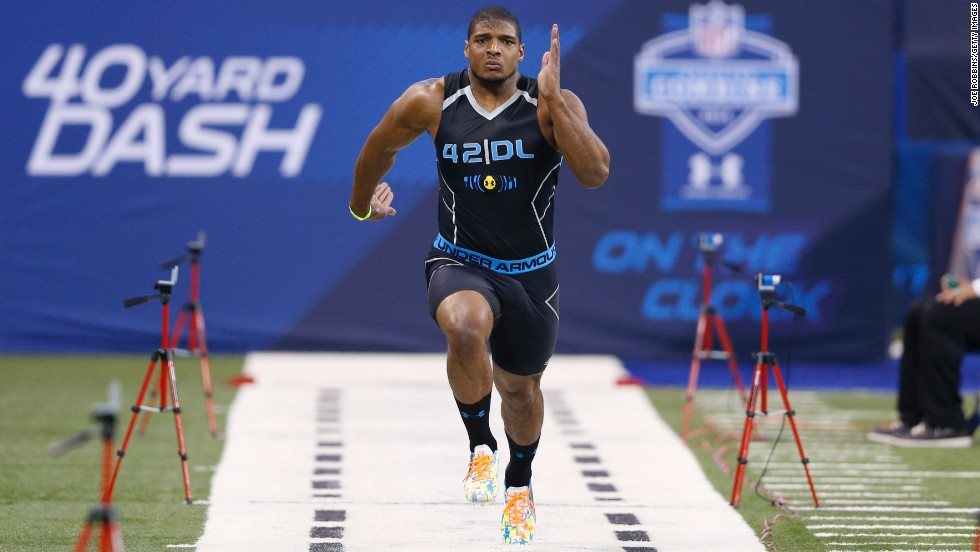Sam runs the 40-yard dash February 2, 2014, during the NFL Scouting Combine in Indianapolis.