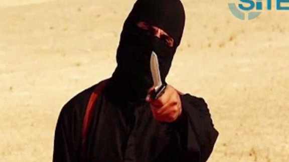 An image grab taken from a video released by the Islamic State (IS) and identified by private terrorism monitor SITE Intelligence Group on September 2, 2014 shows a masked militant holding a knife and gesturing as he speaks to the camera in a desert landscape before beheading 31-year-old US freelance writer Steven Sotloff. The masked militant condemned US attacks on the Islamic State before cutting Sotloff