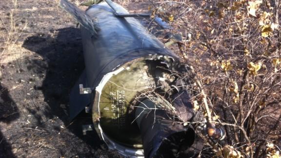 The rocket motor section of a Russian-made SS-21 'Scarab' ballistic missile, found by the CNN team in a field south of Ilovaisk.