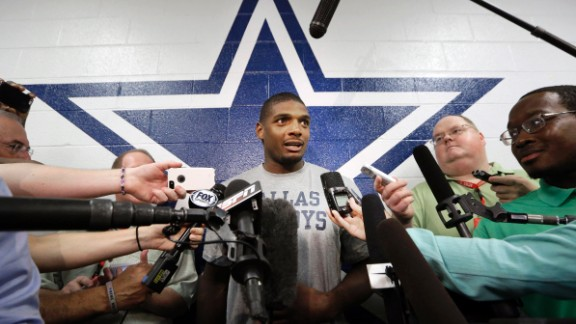 Michael Sam speaks to reporters September 3, 2014, after practicing at the Dallas Cowboys' headquarters in Irving, Texas. Sam did not make the St. Louis Rams' final 53-man roster, but he was signed by the Cowboys to be on their practice squad. He was later waived from the team.