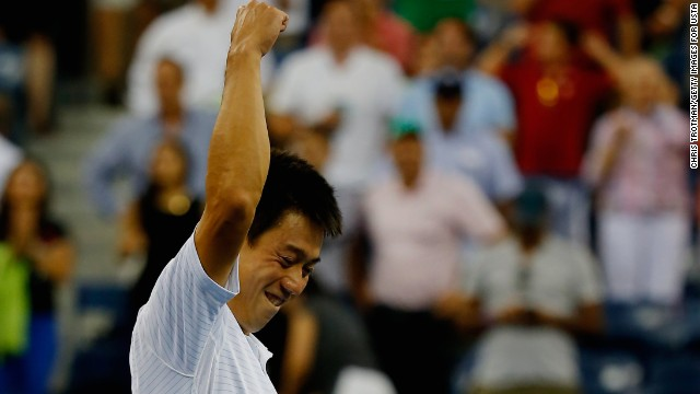 Kei Nishikori of Japan celebrates after defeating Stan Wawrinka of Switzerland in their men's singles quarterfinal match.