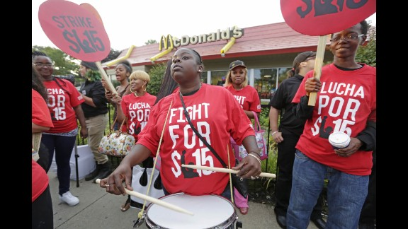 Carmalita Johnson drums as protesters rally outside a McDonald's on Chicago's South Side on September 4.
