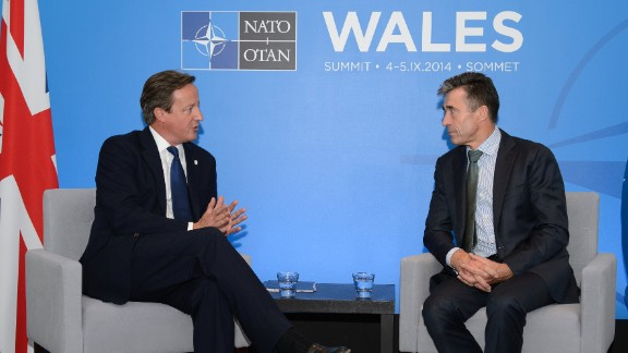 Caption:NEWPORT, WALES - SEPTEMBER 3: British Prime Minister David Cameron (L) meets with NATO Secretary General Anders Fogh Rasmussen at the Celtic Manor Resort on September 3, 2014 in Newport, Wales, United Kingdom. Some 67 world leaders will be attending the NATO summit at Celtic Manor September 4-5. (Photo by Leon Neal - WPA Pool/Getty Images)