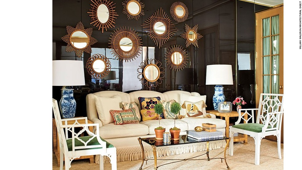 "Another constellation of mirrors shines against a brown-lacquered wall in the en suite waiting room, where a shapely sofa is piled with needlepoint pillows that once belonged to Burch's parents. <a href=""http://www.architecturaldigest.com/decor/2014-09/tory-burch-manhattan-office-slideshow?mbid=synd_cnn"" target=""_blank"">See more photos on ArchDigest.com</a>"