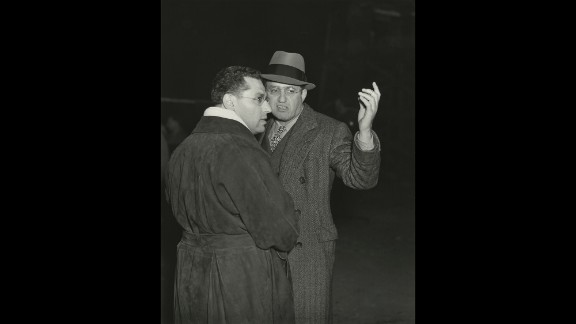 """With no Scarlett yet cast, Selznick, right, and director George Cukor kick off filming with scenes of the burning of Atlanta in December 1938. In """"A Star Is Born"""" moment, Selznick's brother, a famous agent, arrived on the set later with Vivien Leigh. The British actress, then unknown to American audiences, would wow both Selznick and Cukor and soon win the role of a lifetime."""
