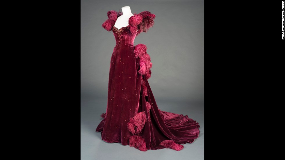 "Scarlett's burgundy ball gown, another original costume on display, is an example of producer David O. Selznick's push for ""show-stopping glamour,"" curator Morena says. ""It's really visually compelling on-screen in a tense moment,"" she says of the shocking outfit Scarlett wears to Ashley's birthday party. ""Vivien Leigh just looks stunning in the dress."""