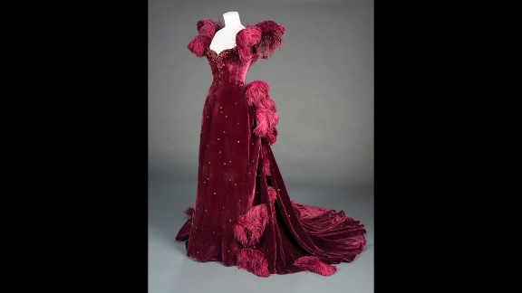 """Scarlett's burgundy ball gown, another original costume on display, is an example of producer David O. Selznick's push for """"show-stopping glamour,"""" curator Morena says. """"It's really visually compelling on-screen in a tense moment,"""" she says of the shocking outfit Scarlett wears to Ashley's birthday party. """"Vivien Leigh just looks stunning in the dress."""""""