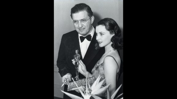 """Leigh celebrates winning the best actress Oscar with Selznick at the Academy Awards ceremony in 1940. """"Gone With the Wind"""" also took home top honors for best picture and director, and the producer received the Irving G. Thalberg Memorial Award for career achievement. """"Selznick was the primary artistic influence on the film. He really pushed everyone,"""" says Wilson, the exhibition curator. """"His hand touched everything."""""""