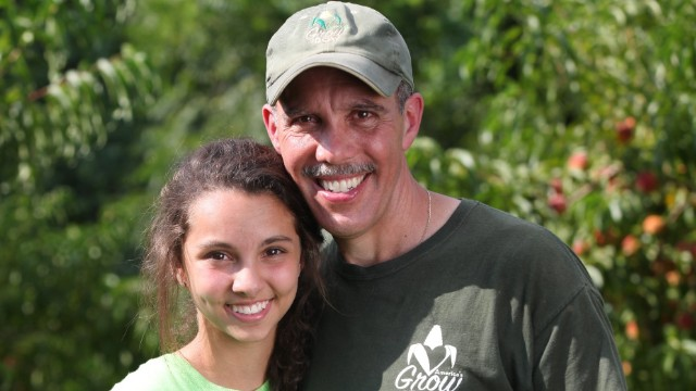 Through his nonprofit, Paillex (pictured with his daughter, Kyra) has provided fresh produce to about 140,000 people