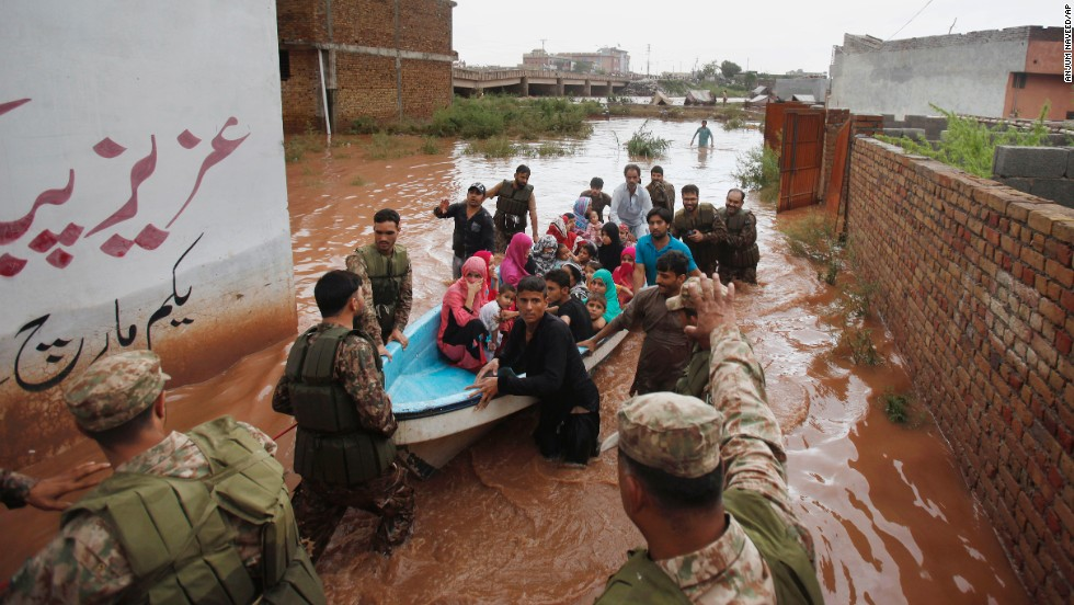 Pakistani soldiers rescue residents from a flooded area on the outskirts of Islamabad on September 5.