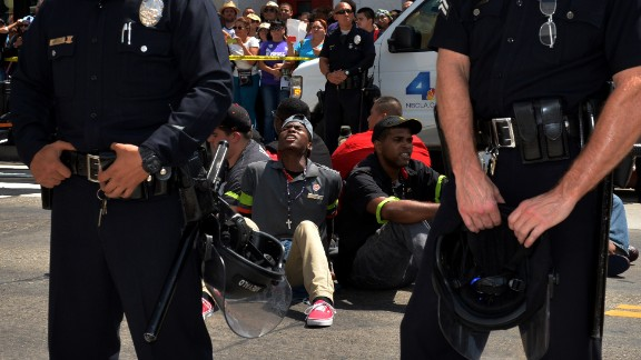 People stage a sit-in before being detained by police outside a McDonald's in Los Angeles on Thursday, September 4. Fast-food workers protested in more than 150 U.S. cities as they called for a mininum wage of $15 an hour and the right to form a union without retaliation.