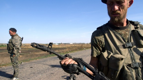 A pro-Russian rebel holds a destroyed weapon in the village of Novokaterynivka, Ukraine, on Thursday, September 4.