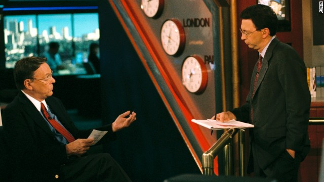 Bruce Morton, seated, talks with colleague Frank Senso in CNN's Atlanta newsroom in 2004.