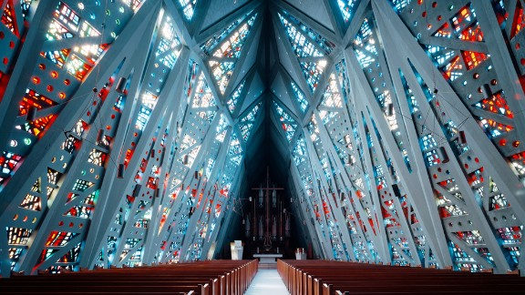 """Grand interiors flooded with light - these churches impress with their huge vaulted ceilings and modernist approach. The First Presbyterian Church, otherwise known as the """"Fish Church"""", is pictured in Stamford, Connecticut. Architect: Wallace K. Harrison."""