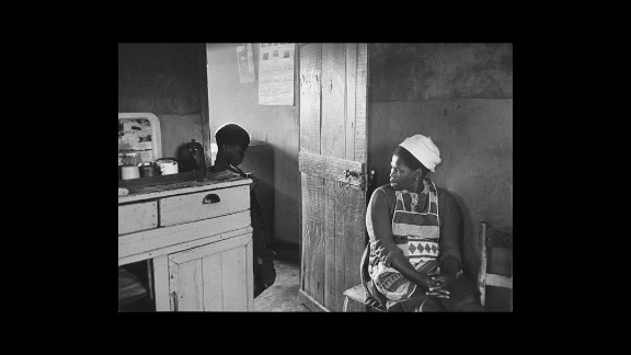 """""""Township mother fights losing battle to keep son, age nine, from running off to live life of the streets. She tries to assert authority with threats: 'What's your future going to be like without an education?' But it is too late; the boy—called Papa—is out of control."""" —House of Bondage, 1967"""