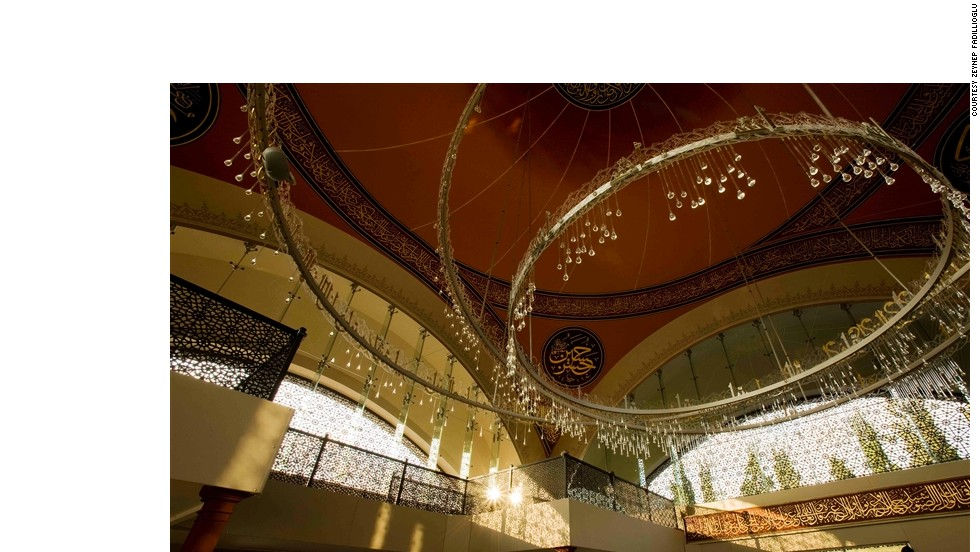 """Beneath the big dome you feel humility,"" said 59-year-old Fadillioglu. ""At the same time, the beautiful chandeliers are much lower than normal, allowing people to feel more secure having this low light above their heads."""