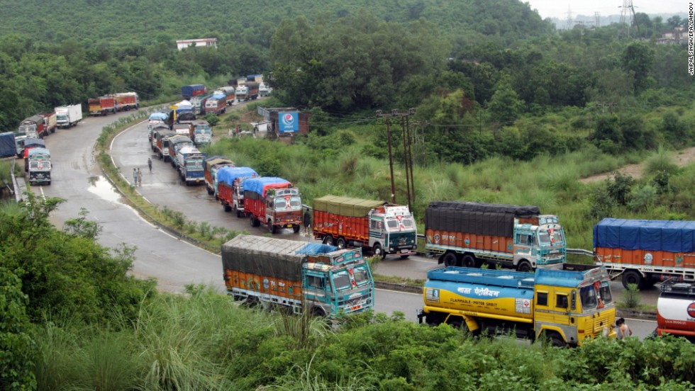 Trucks stranded by flash flooding wait for the Jammu-Srinagar national highway to open on the outskirts of Jammu, India, on September 5.