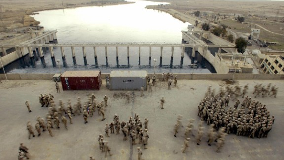 Caption:HADITHA, IRAQ: Marines from the first Battalion 23rd Marines gather in the Haditha's dam deck 250 kms northwest from Baghdad to listen to Brigadier General James L Williams, Commanding 1st Marine Expeditionary Force (MACE) who paid a visit to this base 19 February 2005. US senator Hillary Clinton, wife of former president Bill Clinton, was in Baghdad as part of a delegation from the US Congress led by Senator John McCain that met Iraqi and US military leaders. AFP PHOTO / JAIME RAZURI (Photo credit should read JAIME RAZURI/AFP/Getty Images)