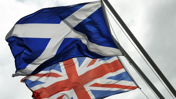 Caption:The Saltire, the flag of Scotland flies above the Union flag at the site of the Auld Acquaintance cairn which is being constructed at a site on the banks of the River Sark in Gretna in Scotland, which is thought to be the historic border between Scotland and England, taken on August 17, 2014. A month to the day until Scotland votes on whether to split from Britain, opinion polls Monday showed the pro-independence camp gaining ground as First Minister Alex Salmond insisted his side had a