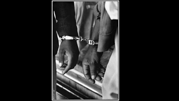 """""""Handcuffed blacks were arrested for being in white areas illegally.""""—House of Bondage, 1967 (According to musician Julian Bahula, a childhood friend of Cole's, the law forbade photography of people being handcuffed by the police.)"""