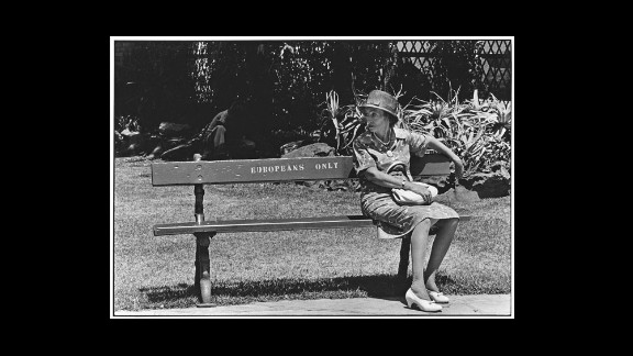 """(Struan Robertson and others report that Johannesburg city benches were inscribed for whites only. There were no """"blacks only"""" benches in Johannesburg; blacks sat on the curbstones.)"""