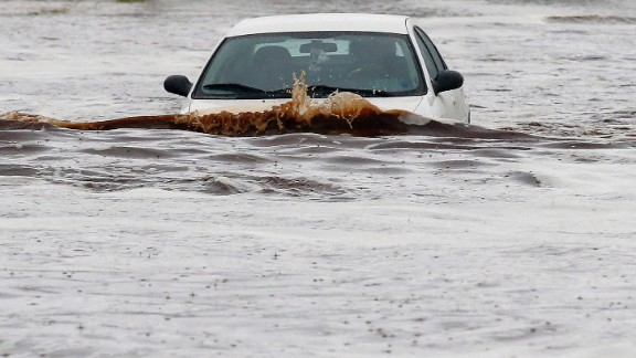 A driver tries to navigate a severely flooded street in Phoenix on September 8.
