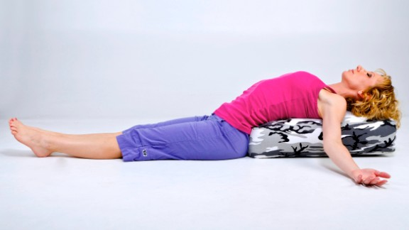 If dropping your head back is too extreme, practice the modified option with your entire back, neck and head resting on a bolster or firm pillow.