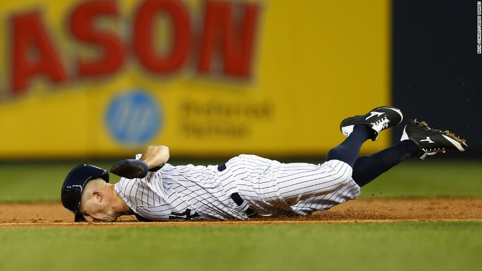 Brett Gardner of the New York Yankees dives into second base as he tries to get a double Wednesday, September 3, in a home game against the Boston Red Sox. He was tagged out on the play.