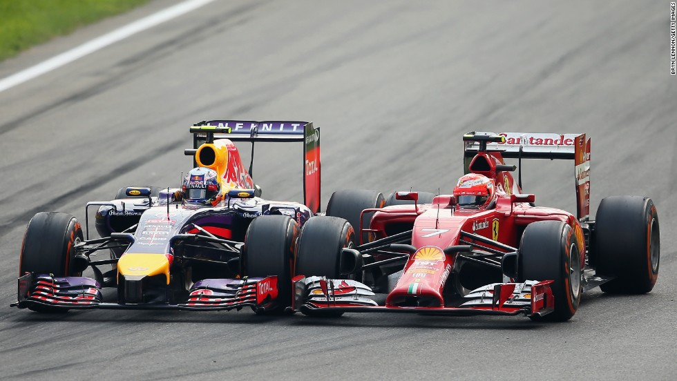 Formula One drivers Daniel Ricciardo, left, and Kimi Raikkonen come together prior to a turn Sunday, September 7, at the Italian Grand Prix in Monza, Italy.