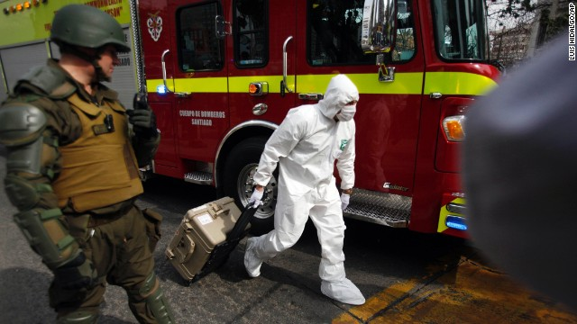 A police forensics expert arrives at the blast site at a subway station in Santiago, Chile, on Monday.