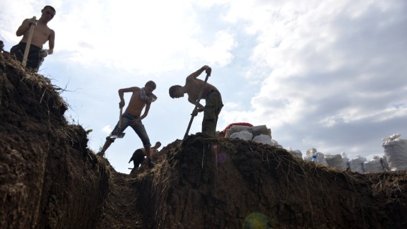 Young residents of Berdyansk, Ukraine, dig trenches September 9 to help Ukrainian forces protect the city from possible rebel attacks.