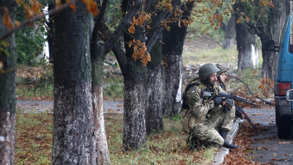 Ukrainian troops protect themselves from a nearby shooting in Debaltseve on Tuesday, September 9.