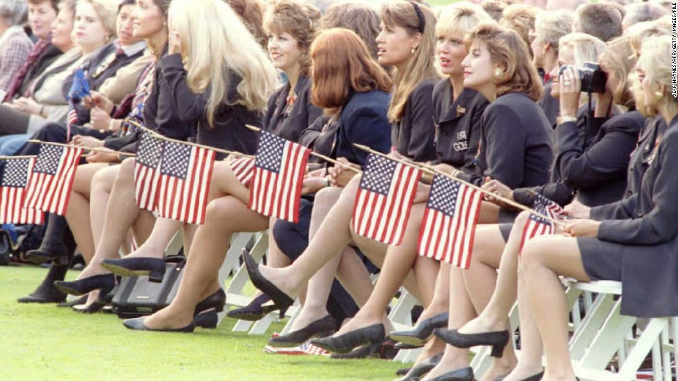 Wives and girlfriends of the United States Ryder Cup team hold American flags during the opening ceremonies of the 1995 Ryder Cup at the Oak Hill Country Club.