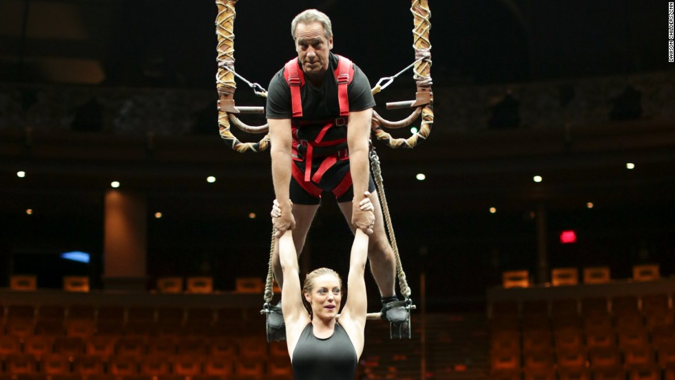 "Rowe holds performer Chelsea Bakken above the pool at the Las Vegas water acrobatic show ""Le Reve."""