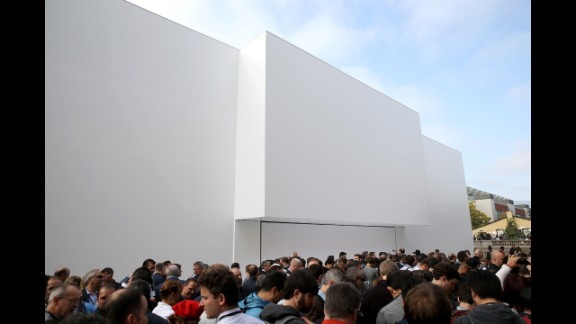 A crowd stands outside of the Flint Center for the Performing Arts ahead of the Apple keynote address Tuesday, September 9, at De Anza College in Cupertino, California.