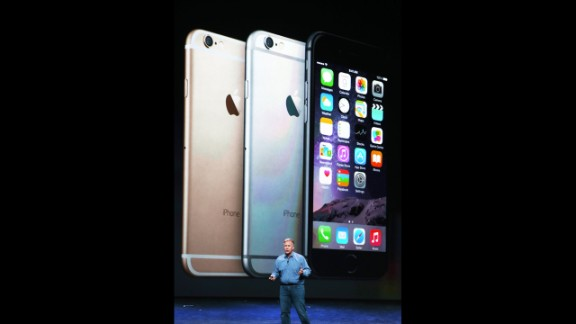 Phil Schiller, Apple's senior vice president of worldwide marketing, announces new iPhones at the event: the iPhone 6 and the iPhone 6 Plus.