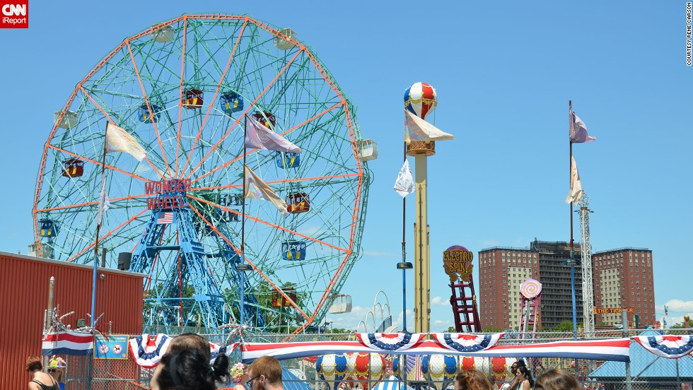"<a href=""http://ireport.cnn.com/docs/DOC-831726"">Coney Island </a>is a Brooklyn neighborhood that features an <a href=""http://coneyislandfunguide.com/"" target=""_blank"">amusement area </a>with dozens of rides and vendors. Its first amusement park was <a href=""http://lunaparknyc.com/about/history/"" target=""_blank"">Sea-Lion Park</a>, which opened in 1903. Pictured above is <a href=""http://www.wonderwheel.com/"" target=""_blank"">Deno's Wonder Wheel Amusement Park</a>, one of several amusement parks operating in Coney Island, drawing scores of visitors daily."