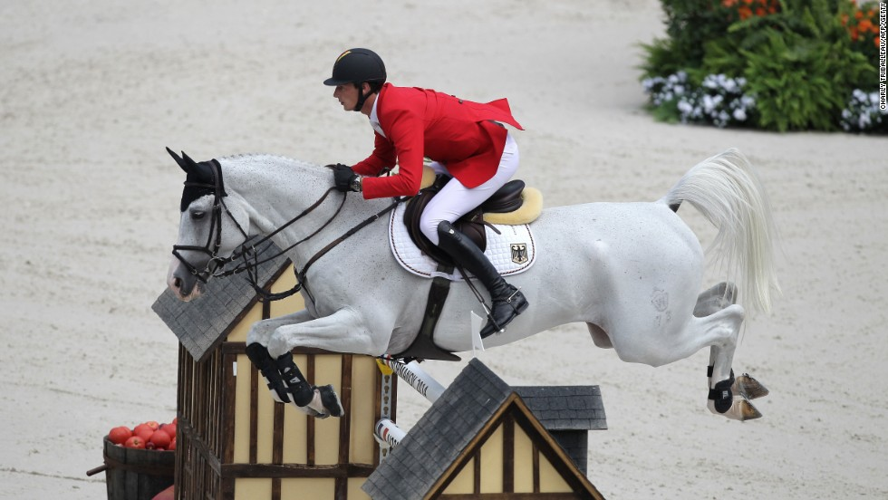 German Daniel Deusser rides Cornet d'Amour on September 3, 2014 during the Individual Jumping competition.