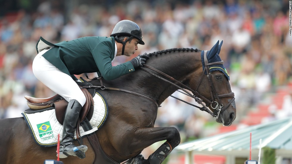 Brazil's Rodrigo Pessoa rides Status as he competes in the Jumping competition on September 4, 2014.