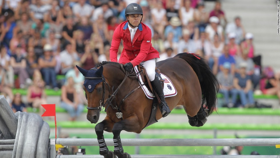 American Kent Farrington rides Voyeur on September 4, 2014 as he competes in the Jumping competition of the 2014 FEI World Equestrian Games, in the northwestern French city of Caen.