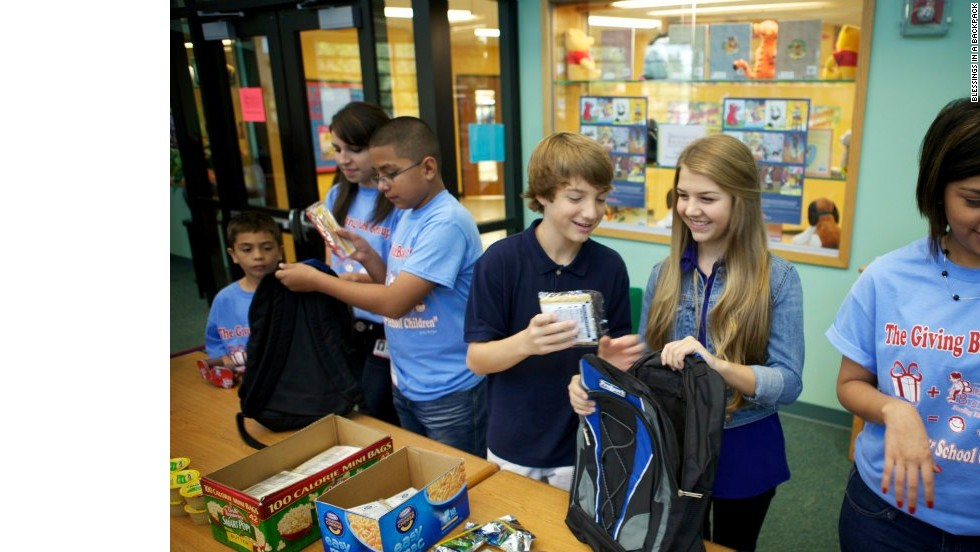 "Disney Channel star and <a href=""http://www.blessingsinabackpack.org/"" target=""_blank"">Blessings in a Backpack</a> supporter Jake Short helps fill backpacks full of food alongside students at Janowskie Elementary in Houston."