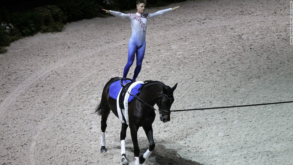 Frenchman Jacques Ferrari rides Poivre Vert in the Individual Men Vaulting Compulsory test of the 2014 World Equestrian Games in the French city of Caen.