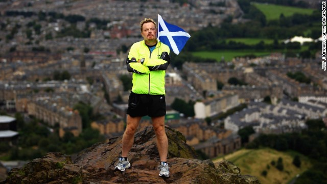 Eddie Izzard stands on the top of Arthur's Seat in Edinburgh in 2009, while running 43 marathons for Sport Relief.
