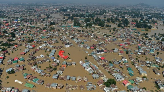 """Kashmiri houseboats and houses submerged by floodwater are seen from an Indian Air Force helicopter during rescue and relief operations in Dal Lake in Srinagar on September 10, 2014. Anger mounted September 10 over the slow pace of rescue operations in Indian Kashmir as authorities said they were """"overwhelmed"""" by the scale of deadly flooding that has left hundreds of thousands of people stranded in India and Pakistan. The death toll from the cross-border disaster surpassed 450 as emergency workers in both countries scrambled to rescue marooned residents in the worst-hit areas. AFP PHOTO/Tauseef MUSTAFATAUSEEF MUSTAFA/AFP/Getty Images"""