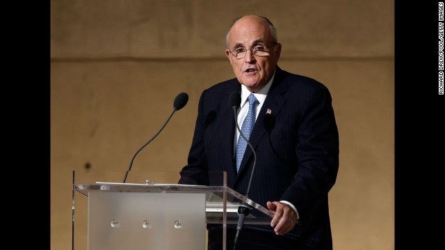 "NEW YORK, NY - MAY 15:  Former New York Mayor Rudolph Giuliani speaks during the dedication ceremony in Foundation Hall at the National September 11 Memorial Museum at ground zero May 15, 2014 in New York City. The museum spans seven stories, mostly underground, and contains artifacts from the attack on the World Trade Center Towers on September 11, 2001 that include the 80-foot high tridents, the so-called ""Ground Zero Cross,"" the destroyed remains of Company 21's New York Fire Department Engine as well as smaller items such as letter that fell from a hijacked plane and posters of missing loved ones projected onto the wall of the museum. The museum will open to the public on May 21. (Photo by )"