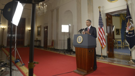 "US President Barack delivers a prime time address from the Cross Hall of the White House on September 10, 2014 in Washington, DC.  Vowing to target the Islamic State with air strikes ""wherever they exist"", Obama pledged to lead a broad coalition to fight IS and work with ""partner forces"" on the ground in Syria and Iraq.  AFP PHOTO/POOL/Saul LOEB        (Photo credit should read )"