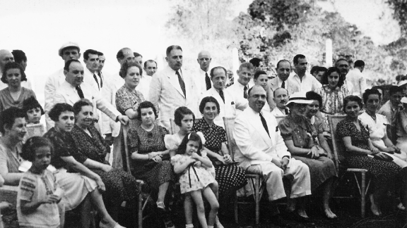 From 1937 to 1941, about 1,200 European Jews found refuge from the Holocaust in the Philippines. Their migration was part of an effort by the Philippines president, Manuel Quezon, the Jewish-American Frieder family, and an American official, Paul McNutt. Several of the Jewish refugees pose with Mr. and Mrs. Alex Frieder in this 1940 picture in the Philippines.